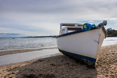 Beached Fishing Boat # 2. A fishing boat washed up on a beach from a  recent storm in Melbourne Royalty Free Stock Image