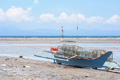 Beached fishing vessel in The Philippines Stock Image