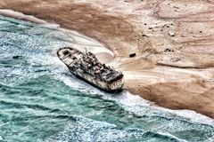 Beached. Merchant ship that was once taken hostage by Somali Pirates but a ransom was never paid for the vessel so it remains run aground on the beautiful shores Royalty Free Stock Images