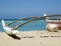 Beached Outrigger Canoe. Outrigger canoe on the beach with ocean background. Location- Honolulu Hawaii Royalty Free Stock Photo