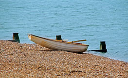 Beached rowing boat Stock Images