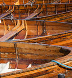 Beached Rowing Boats. Beached wooden Rowing boats in bright sunlight. England royalty free stock image