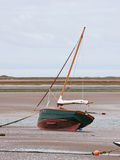 Beached sail boat at low tide Royalty Free Stock Images