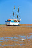 Beached sailing. A beached sailing boat at low tide on the beach of Toliara, Madagascar royalty free stock photos