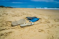 Beached sandles or flip flops royalty free stock image