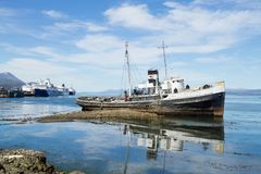 Beached ship on Ushuaia port, Argentina landscape. Southernmost city in the world. Beached ship on Ushuaia port, Argentina landscape beagle channel fire tierra royalty free stock photo