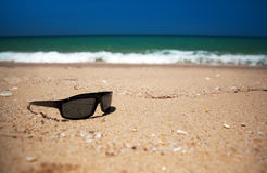 Beached sunglasses Royalty Free Stock Photos
