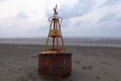 Beached warning buoy Royalty Free Stock Photo