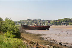 Beached wreck on a tidal riverbed. Beached wreck on the Tidal River Torrington in North Devon stock image