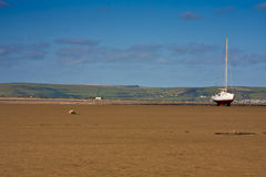 Beached yacht. Yacht or boat on beach waiting for high tide on devon coast Royalty Free Stock Images
