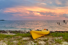 A beached yellow sea kayak on the beach at Fort Jefferson at sun Stock Image