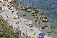 Beaches in Alupka are stony, despite this popular among holidaymakers. ALUPKA, CRIMEA, UKRAINE - AUGUST 20, 2012: Beaches in Alupka are stony, despite this stock photo