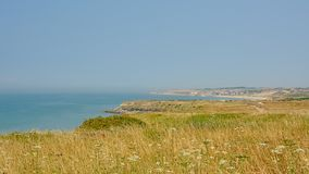 Beaches and cliffs of the French Opal north sea coast near Boulogne sur mer. Nord Pas De Calais, France on a sunny day with blue sky royalty free stock photo