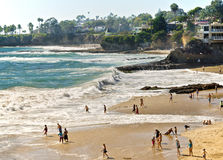 Beaches and Coves, Laguna Beach California. People play along the beaches between the coves in the coastal city of Laguna Beach, southern California, on the Royalty Free Stock Photo
