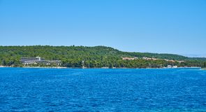 Beaches of Hvar, Croatia. Turquoise waters, green pine trees and rocks royalty free stock photos
