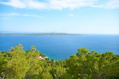 Beaches of Hvar, Croatia. Turquoise waters, green pine trees and rocks stock image