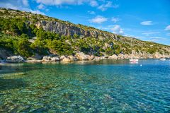 Beaches of Hvar, Croatia. Turquoise waters, green pine trees and rocks stock photography