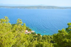 Beaches of Hvar, Croatia. Turquoise waters, green pine trees and rocks stock images