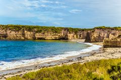 The beaches of Pacific. The concept of exotic, active and photo-tourism. Picturesque seashore, coastal cliffs and sandy beaches of the Pacific. Great Ocean Road royalty free stock image