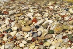 The beaches of Rhodos are beautiful with pebbles. Beautiful and varied textures can be photographed from the colorful pebble beach. Great for backgrounds and royalty free stock photo