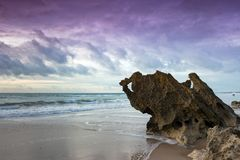 Beaches of roche. In Cadiz at sunset with storm clouds Royalty Free Stock Images