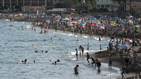 Beaches of southern Spain and swimmers crowded on a summer afternoon. Beaches of southern Spain and swimmers crowded stock video