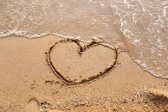 Beaches waves and heart shape drawn. Stock Image