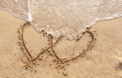 Beaches waves and heart shape drawn. Stock Photo