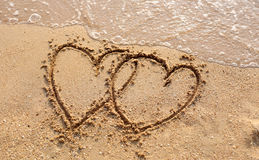 Beaches waves and heart shape drawn. Royalty Free Stock Image