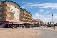 Lacanau, Atlantic Ocean, France, main street. Beachfront buildings, shops and restaurants in Lacanau, a French seaside resort on the Atlantic Coast and a well Royalty Free Stock Image