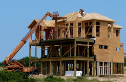 Beachfront Construction. Construction workers building a beachfront home at the Outer Banks of North Carolina Stock Images