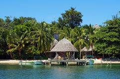Beachfront eco resort with thatched hut Royalty Free Stock Photo