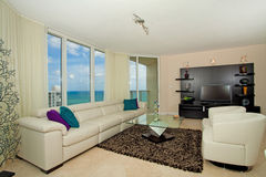 Beachfront living room. A beach front luxury living room in a condo Royalty Free Stock Images