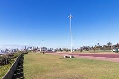 Beachfront Promenade against Blue Durban City Skyline Royalty Free Stock Images