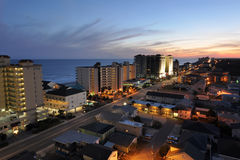 Beachfront properties, buildings, and city lights. Lively resort strip along the coast at night, with vacation rentals and beachfront properties royalty free stock photos