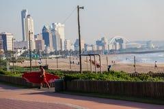 Beachfront SUP Rider Royalty Free Stock Image