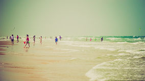Beachgoers Enjoying the Beach on South Padre Island, Texas Royalty Free Stock Photo