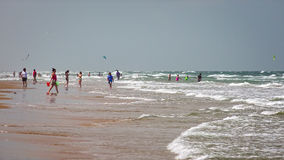 Beachgoers Enjoying the Beach on South Padre Island, Texas Stock Photos