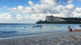 Beachgoers at a tropical resort. Beachgoers play on a tropical resort beach stock video footage