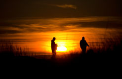 Beachgoers at sunset near Ocean Shores Stock Photo