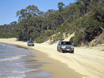 BeachHighway. Two 4wd driving along the beach highway Royalty Free Stock Photo