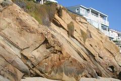 Beachhouse. Beach house settled up on the cliffs above the ocean Royalty Free Stock Photo