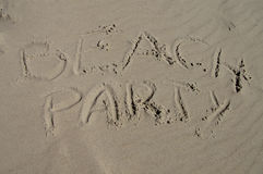 Beachparty. The word beachparty written into the sand on the beach in two lines Stock Photo