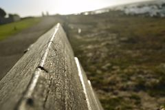 Beachside bench. This is a close-up of a beachside bench taken in Melkbosstrand Capetown Stock Photo