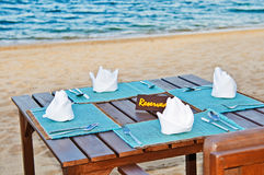 Beachside Dining. A table reserved for a special occaision right on the beach Stock Photos