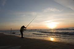 Beachside fishing Stock Photography