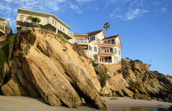 Beachside homes at Woods Cove Beach in Laguna Beach, California. Image shows beachside homes built on a rocky bluff above Woods Cove Beach in South Laguna Beach royalty free stock image