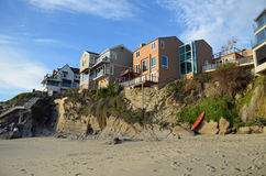Beachside homes at Woods Cove Beach in Laguna Beach, California. Image shows beachside homes built on a rocky bluff above Woods Cove Beach in South Laguna Beach stock image