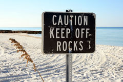 Beachside Warning Sign. To keep off rocks.  Shot in beautiful south Florida Stock Image
