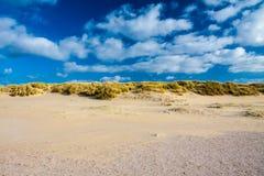 Beachside Zeeland. With cloudy sky Stock Photos